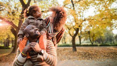 young family enjoying fall weather