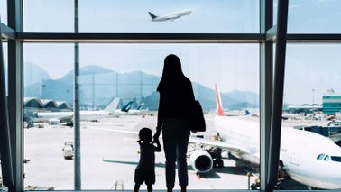 Mom and daughter traveling for holidays