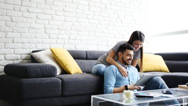 Couple researching life insurance premium costs