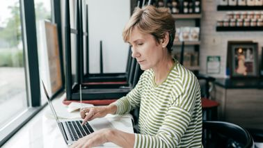 Business owner researching tax law changes
