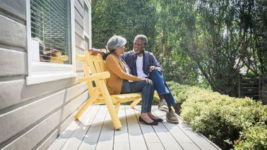 Before retiring, a couple sits outside having a conversation about retirement