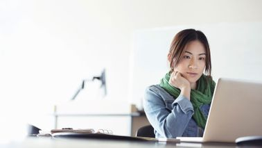 How to make sure email doesn't take over your day woman at desk