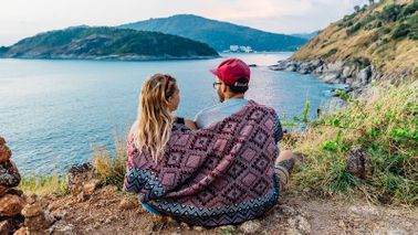 Should You Switch to Your Spouse's Health Insurance couple on the sea