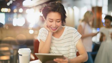 Woman on tablet wondering if she should max out her 401k contribution