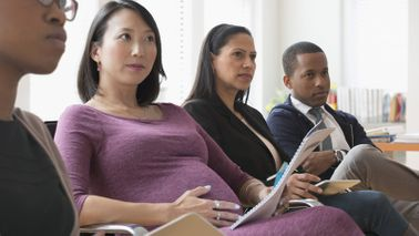 Pregnant woman preparing for maternity leave