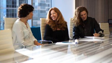 Ann Lawrence in an office helping other women succeed