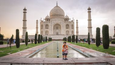 Kids on a trip around the world by the Taj Mahal