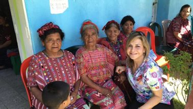 Financial planner on a trip in Guatemala with the locals