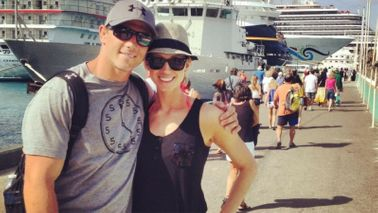 Couple by a cruise ship after taking control of their finances