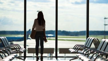 Woman waiting for a flight at the airport.