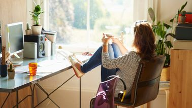 Woman at a desk.