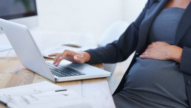 Pregnant freelancer preparing for maternity leave.