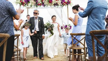 Beach wedding of older couple