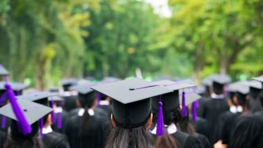 Graduates wearing their mortarboards.