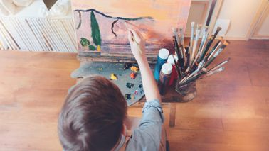 boy painting in anything room