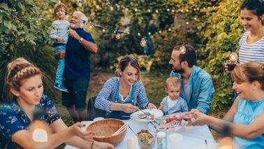 multi-generational family enjoying mid-yard dining experience