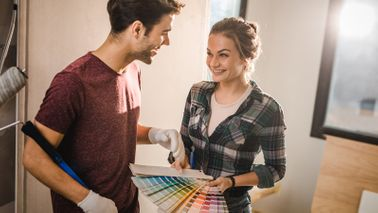 Couple picking paint colors for a home they're building in a new development.