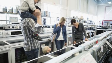 Family shopping for appliances.