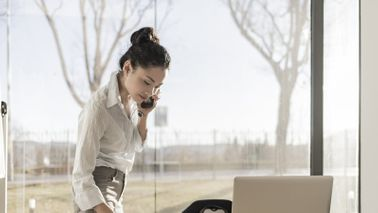 woman on the phone at her desk