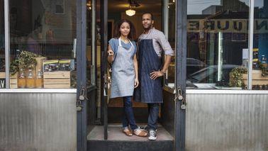 Business owners in doorway.