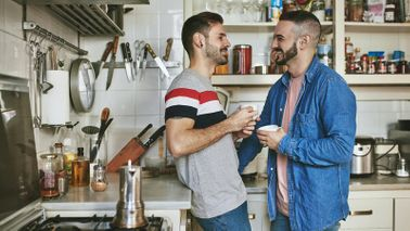couple discussing money differences it kitchen