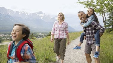 Family hiking at a ski resort in the summer.