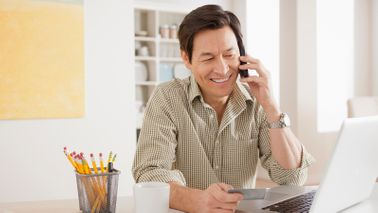 man negotiating credit card interest rate over the phone