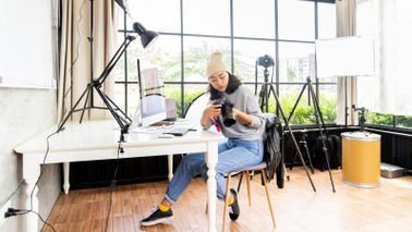 Woman who took financial steps before starting her photography business.