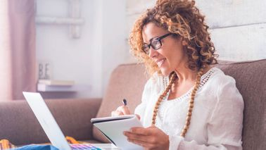 woman calculating how to catch up on retirement