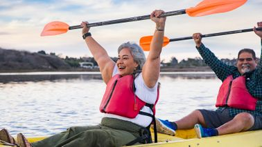 senior couple kayaking in retirement