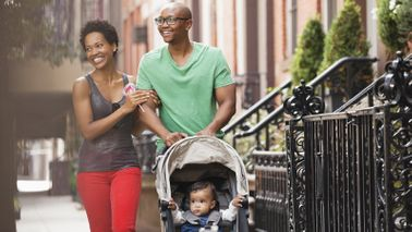 Family walking down street thinking about the critical role whole life insurance plays in their financial plan.