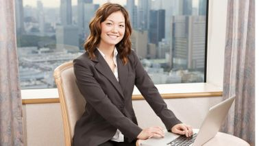 Businesswoman smiling about her year-end bonus