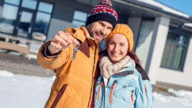 Young couple buying a house in winter.