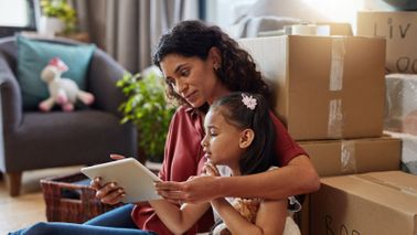 Woman reading from a tablet with her daughter
