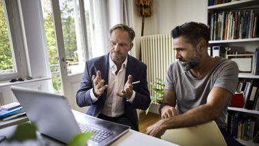 A financial advisor discusses a plan with his client