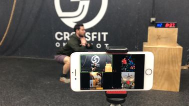 Chase Ford hosting an online class at his gym, CrossFit One Shot.
