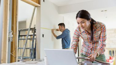 Young couple working on home renovations
