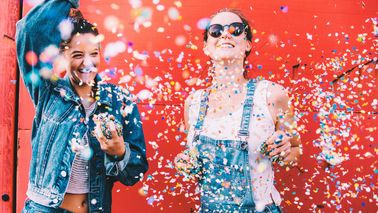 two girls celebrating in confetti