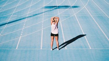 woman warming up on track