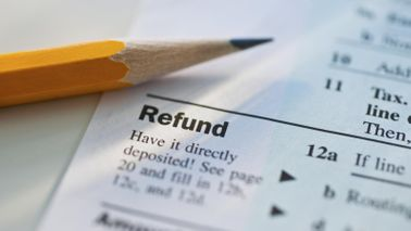 Close up on pencil on refund portion of tax return.
