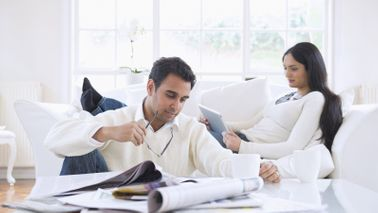 Man and woman reading Northwestern Mutual Market Commentary