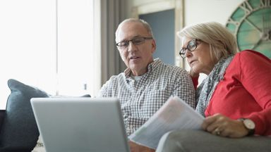 Older couple researching how much it costs to retire