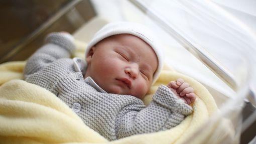Baby in a nursery.