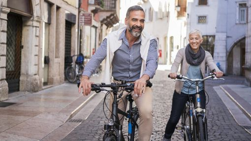 Retired couple on bicycles abroad
