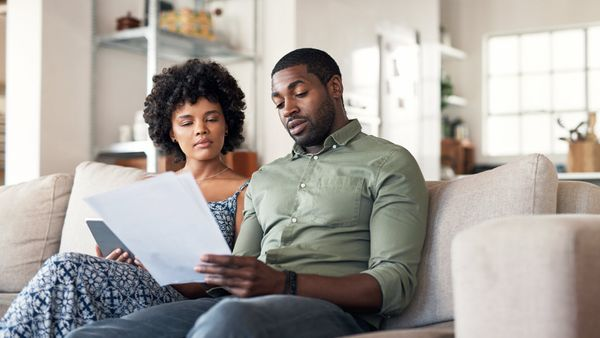 Couple looking at their budget and considering a financial plan as the coronavirus has changed how we think about money