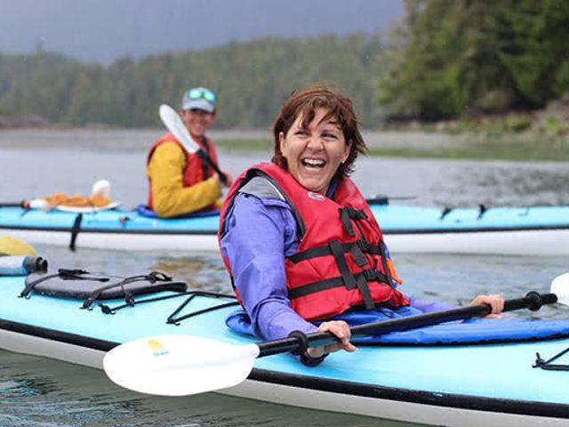 couple kayaking while on mid-cruise adventure