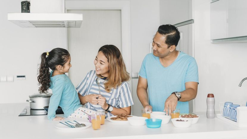 family on a budget making breakfast at home