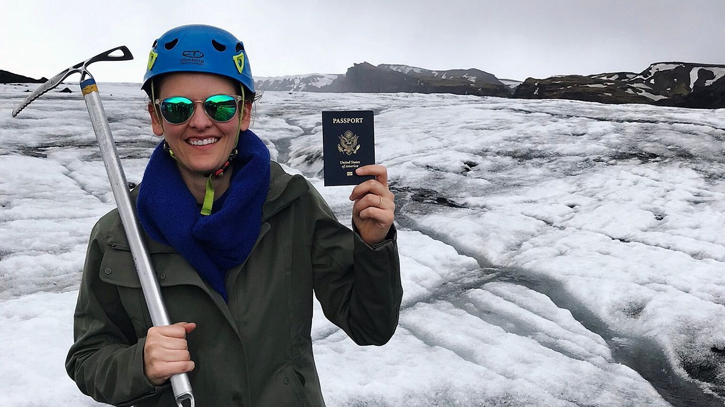 Claire Young shows off her freshly-renewed passport while on vacation in Iceland
